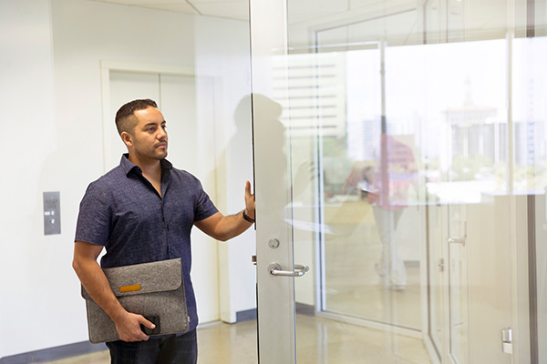 Man entering glass office door