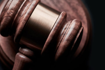 Judge's gavel on black background