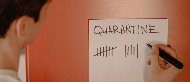 Man marking off quarantine days