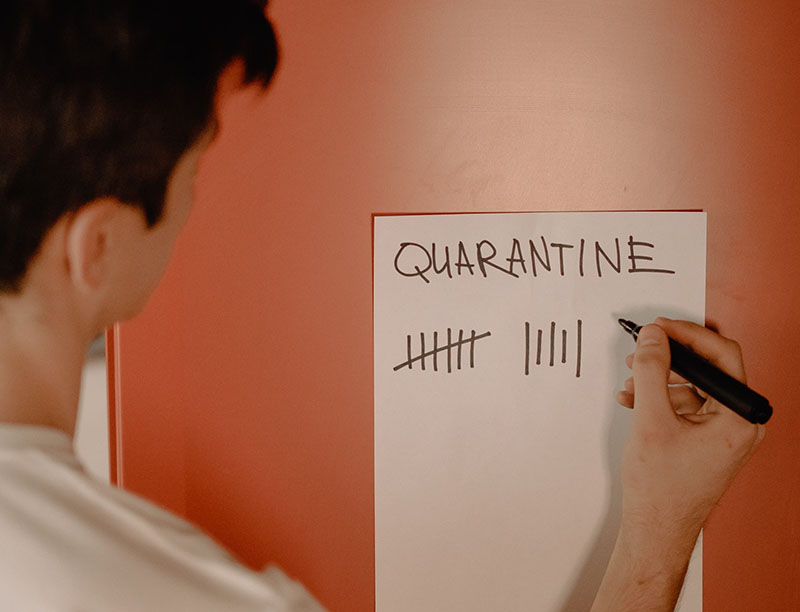 Man marking off quarantine days