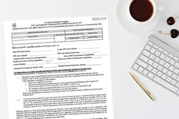 PPP Loan Forgiveness Paper Application on Desk